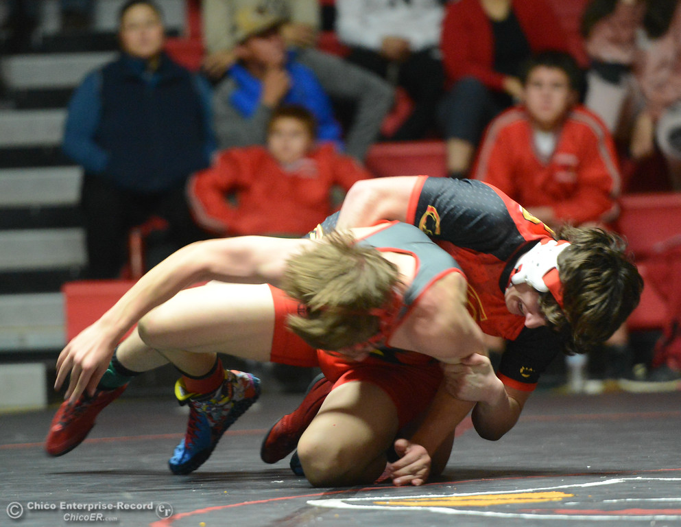 . Chico\'s Dylan Stowie  wrestles Corning\'s Rocco Raker in the 145 weight class Wednesday November 29, 2017 in Corning, California. (Emily Bertolino -- Enterprise-Record)
