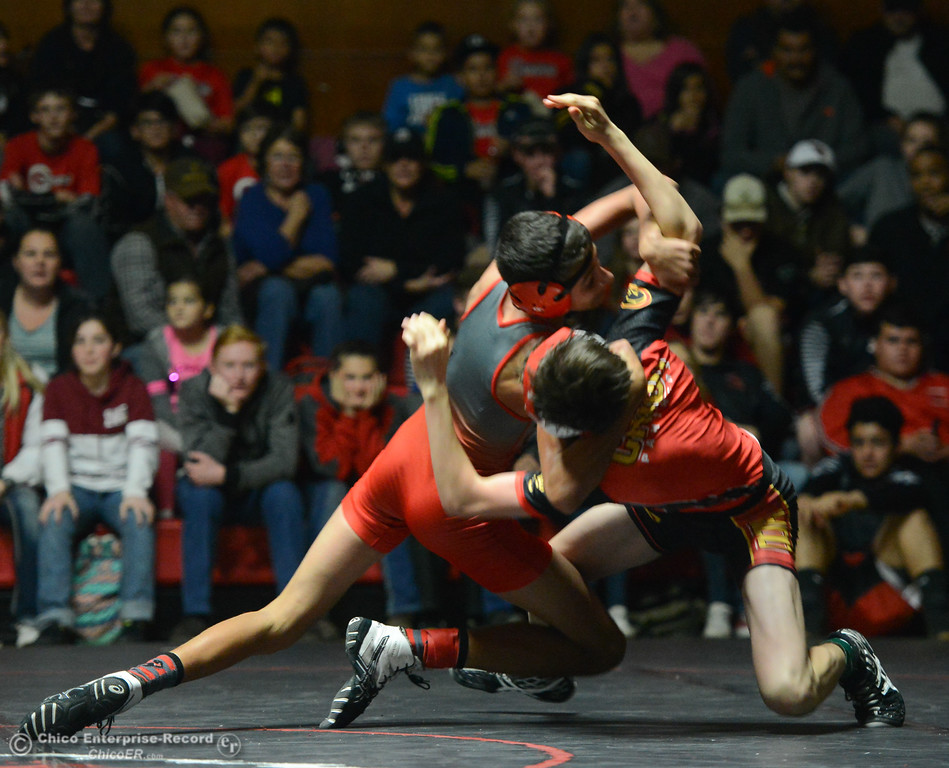 . Corning\'s Loki Orduno wrestles Chico\'s Liam Sehorn in the 113 weight class Wednesday November 29, 2017 in Corning, California. (Emily Bertolino -- Enterprise-Record)