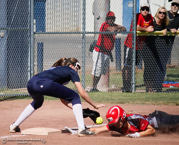 Chico High's Marissa Woolsey beats Pleasant Valley's Cheyenne Wilson to the bag during  the  Northern Section Division II championship softball game Wednesday May 17, 2017 in Chico California, California. Chico High goes on to win the NSCIF title 11-6 over Pleasant Valley.  (Emily Bertolino -- Enterprise-Record)