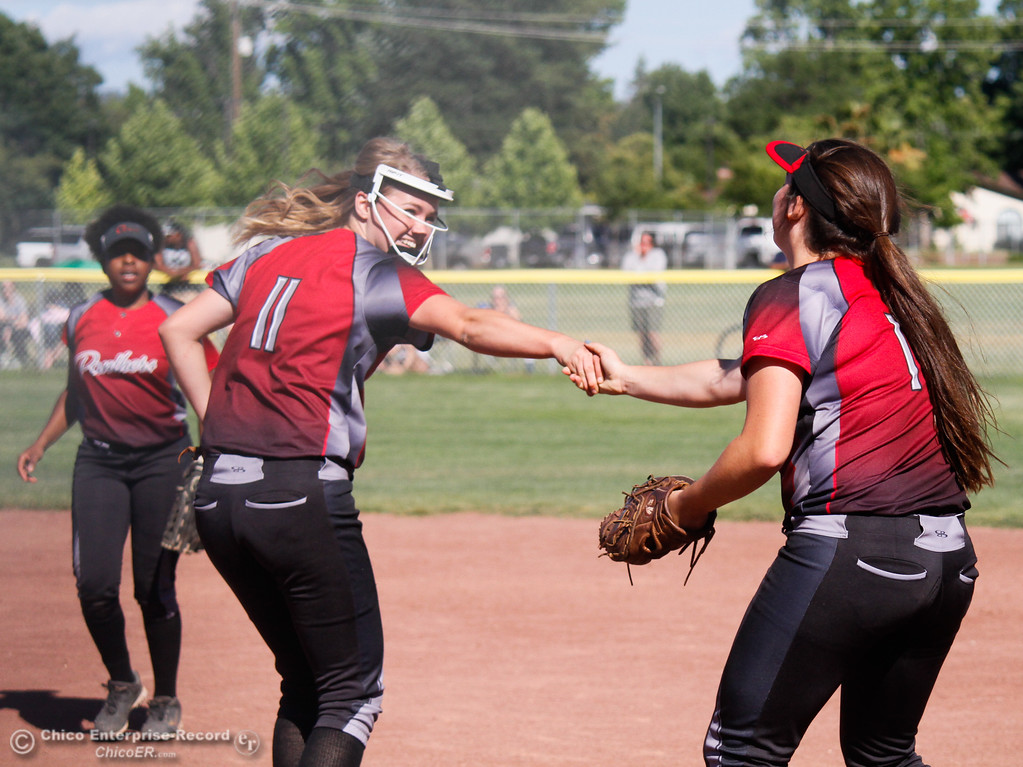 . Chico High\'s pitcher Taylor Culp celebrates with team mate Mallorie Tebo after a successful play against Pleasant Valley the  Northern Section Division II championship softball game Wednesday May 17, 2017 in Chico California, California. Chico High goes on to win the NSCIF title 11-6 over Pleasant Valley.  (Emily Bertolino -- Enterprise-Record)