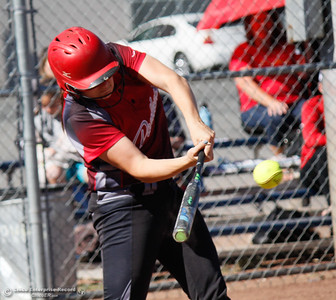 Chico High's Mallorie Tebo hits a two run home run in the third inning during the Northern Section Division II championship game against Pleasant Valley Wednesday May 17, 2017 in Chico California, California. Chico High goes on to win the NSCIF title 11-6 over Pleasant Valley.  (Emily Bertolino -- Enterprise-Record)