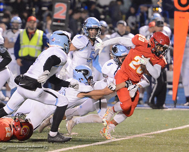 Chico High's Jalen Johnson pulls through Pleasant Valley's defense in the Northern Section Division II semifinal football game Friday November 17, 2017 at Asgard Yard in Chico, California. (Emily Bertolino -- Enterprise-Record)