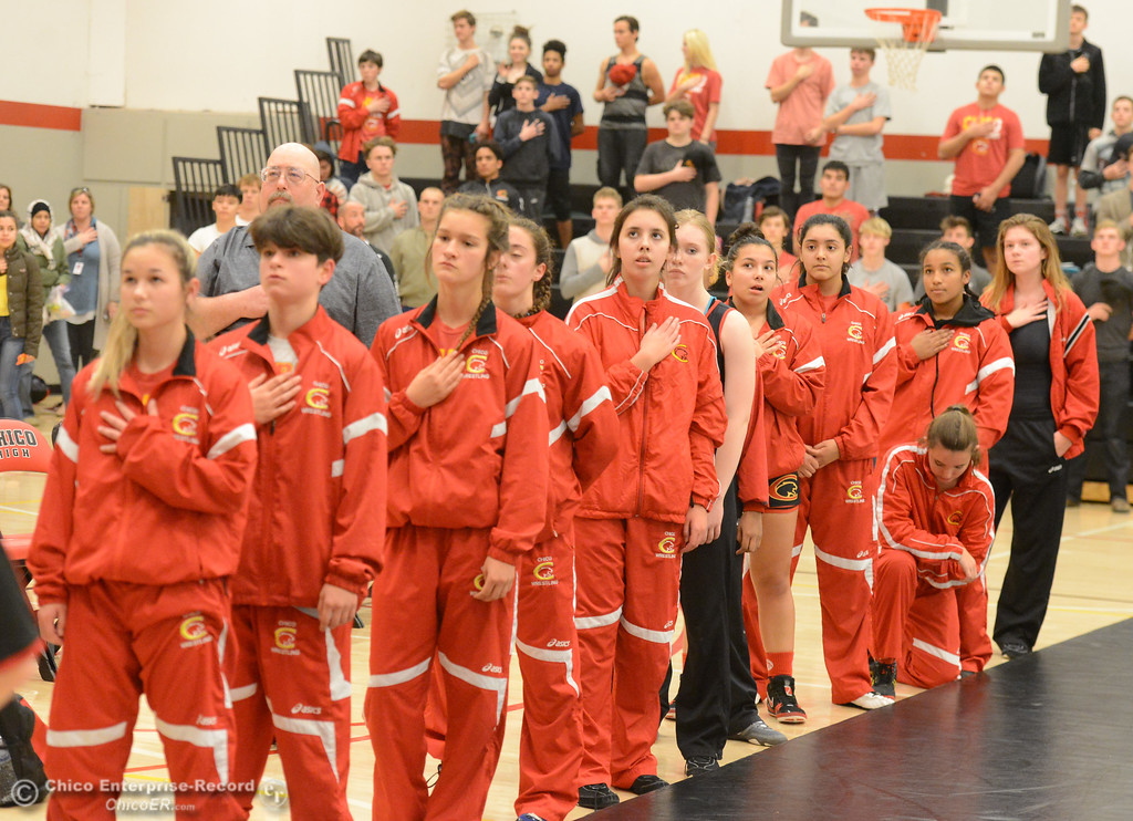 . The Chico High girls wrestling team stands for the National Anthem during the first ever all girls dual meet in the Northern Section against Del Oro Wednesday December 6, 2017 in Chico, California. (Emily Bertolino -- Enterprise-Record)