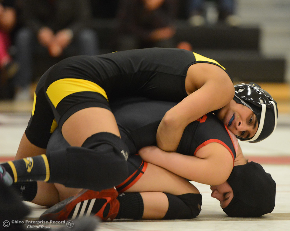 . Chico High\'s Konner Sims wrestles Del Oro\'s Layla Sidhu in the first ever all girls dual meet in the Northern Section Wednesday December 6, 2017 in Chico, California. (Emily Bertolino -- Enterprise-Record)
