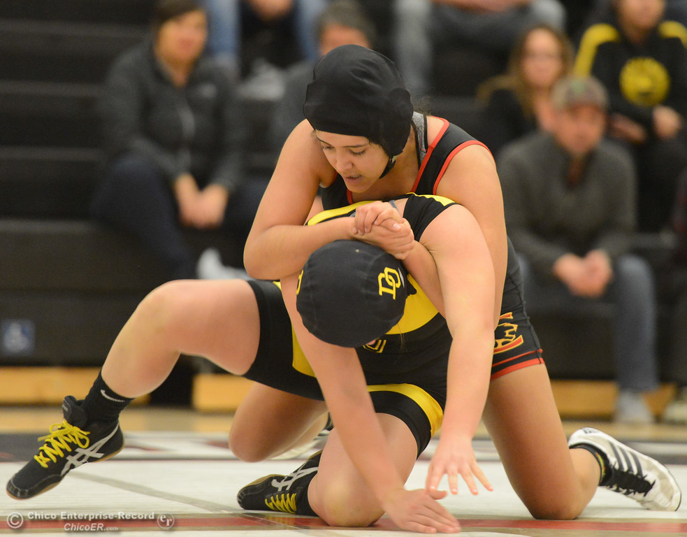 . Chico High\'s Mariela Galvan wrestles Del Oro\'s Jessica Beavers in the first ever all girls dual meet in the Northern Section Wednesday December 6, 2017 in Chico, California. (Emily Bertolino -- Enterprise-Record)