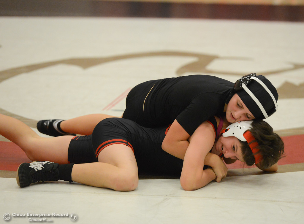 . Chico High\'s Faith Rhodes wrestles Del Oro\'s Jordan Pausner in the first ever all girls dual meet in the Northern Section Wednesday December 6, 2017 in Chico, California. (Emily Bertolino -- Enterprise-Record)