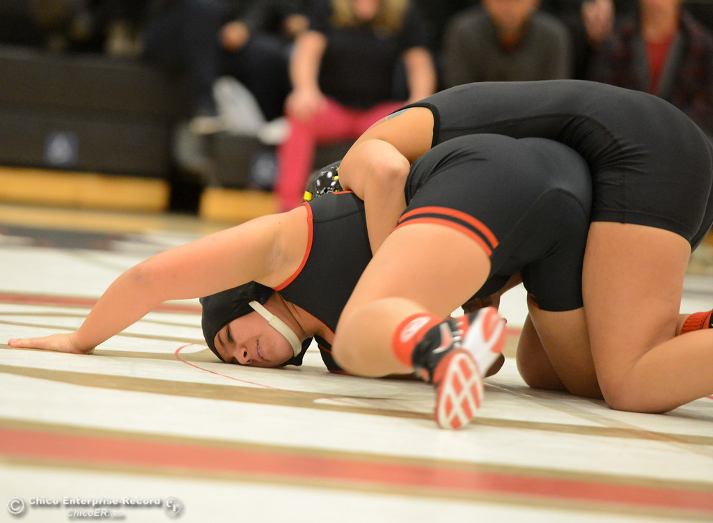 . Chico High\'s Lily Sajadi wrestles Del Oro\'s Candace Carralejo in the first ever all girls dual meet in the Northern Section Wednesday December 6, 2017 in Chico, California. (Emily Bertolino -- Enterprise-Record)