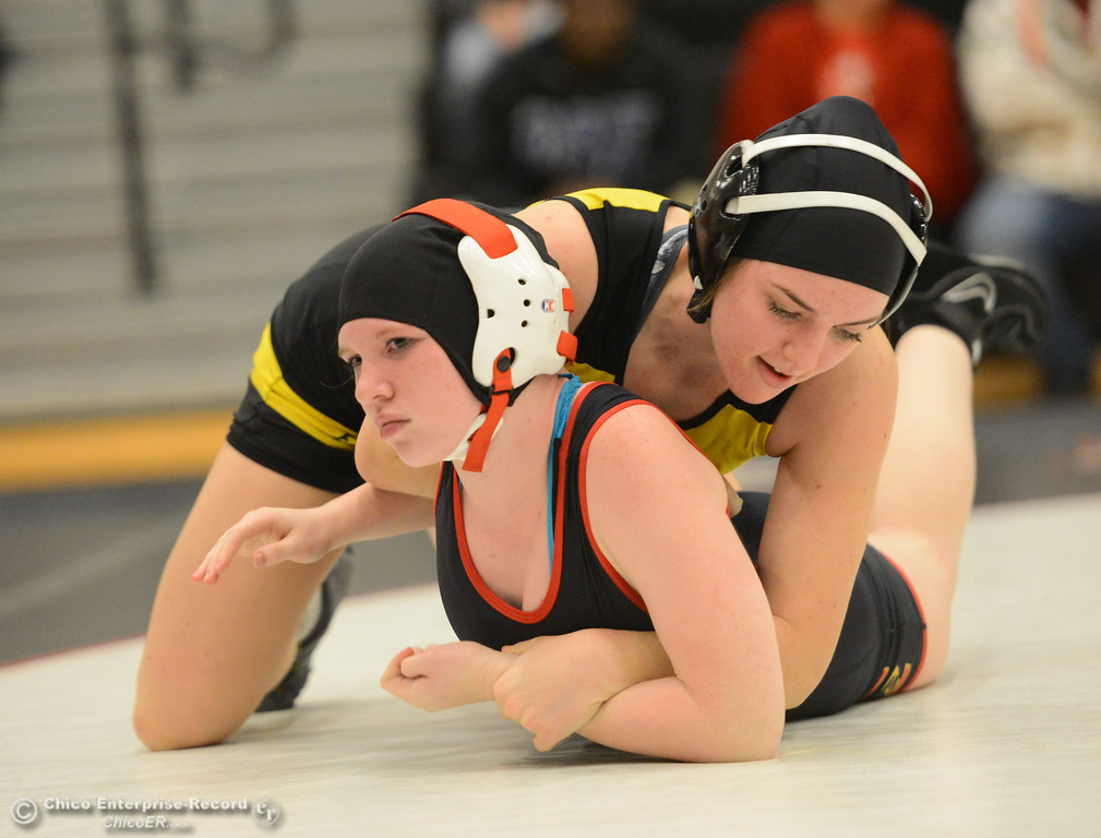 . Chico High\'s Sarah Paris wrestles Del Oro\'s Macy Lockyer in the first ever all girls dual meet in the Northern Section Wednesday December 6, 2017 in Chico, California. (Emily Bertolino -- Enterprise-Record)