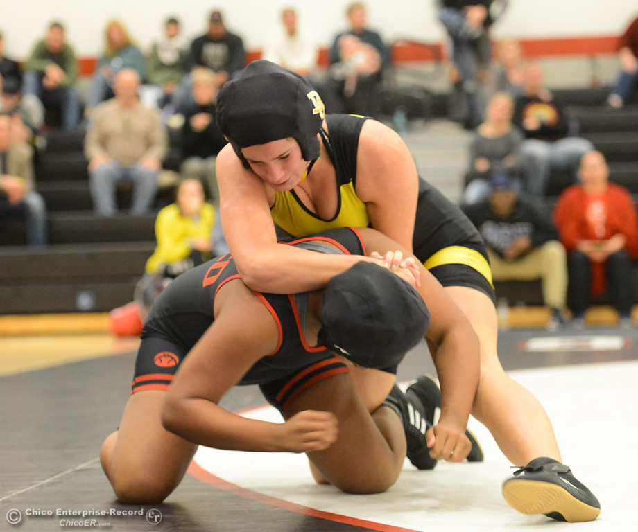 . Chico High\'s Annalyah Mendon wrestles Del Oro\'s Jade Nelson to win with a pin in the first ever all girls dual meet in the Northern Section Wednesday December 6, 2017 in Chico, California. (Emily Bertolino -- Enterprise-Record)