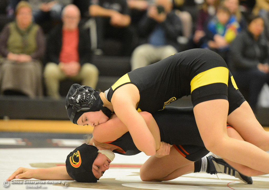 . Chico High\'s Melody Hervey  wrestles Del Oro\'s Stacy Culmer in the first ever all girls dual meet in the Northern Section Wednesday December 6, 2017 in Chico, California. (Emily Bertolino -- Enterprise-Record)