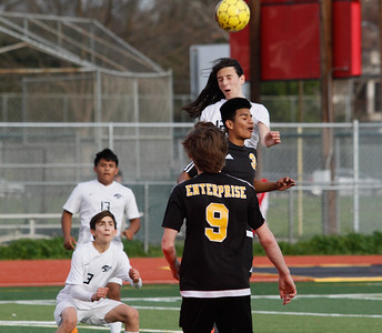 Chico High's Isaiah Guiterrez jumps over Enterprise's Victor Ramirez for the header during a playoff soccer game February 16, 2017 in Chico, California. (Emily Bertolino -- Enterprise-Record)
