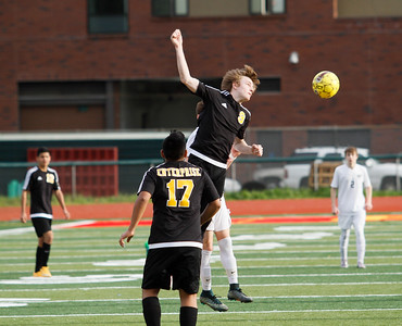 Enterprise High's Brock Fischer heads as Chico High hosts the Hornets in a playoff soccer game February 16, 2017 in Chico, California. (Emily Bertolino -- Enterprise-Record)