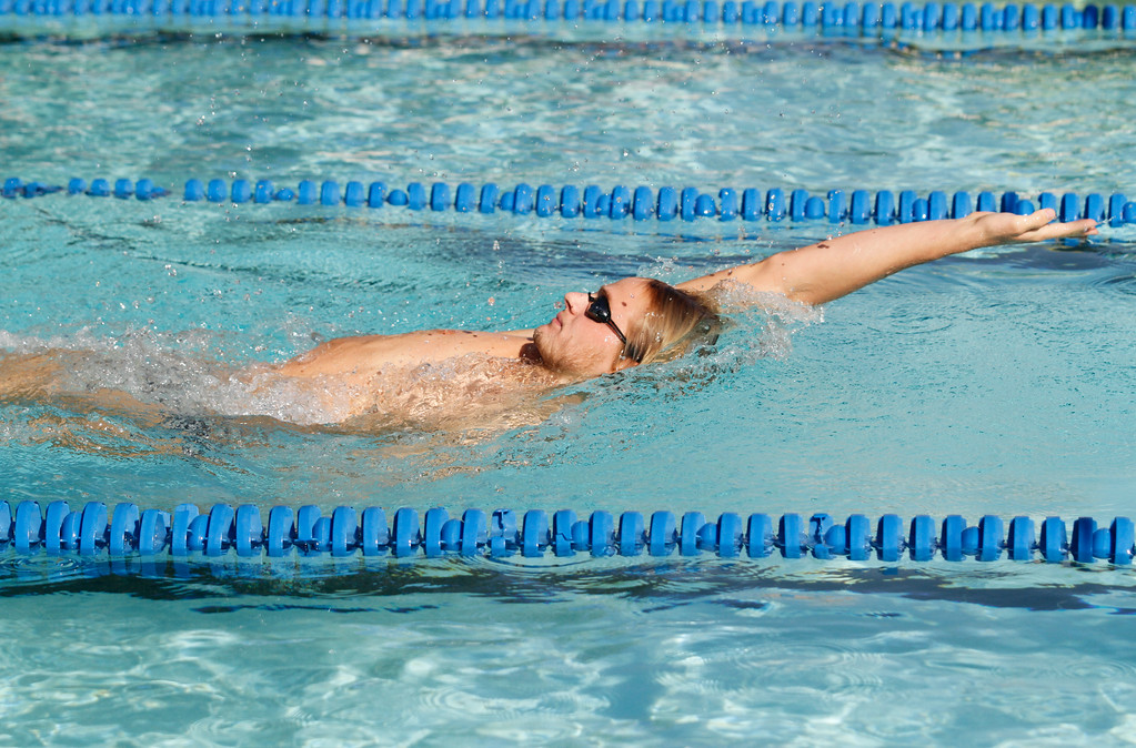 . Chico High\'s Liam Davis swims backstroke during the 200 I.M. to place first as the Panthers hosts Foothill in a dual swim meet Wednesday September 13, 2017 Bidwell Junior High in Chico, California. (Emily Bertolino -- Enterprise-Record)