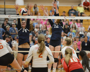 Pleasant Valley's Julia Shepherd (14) and Colette Florentine (12) go up for the block against Chico High Thursday October 5, 2017 at Chico High School in Chico, California. (Emily Bertolino -- Enterprise-Record)