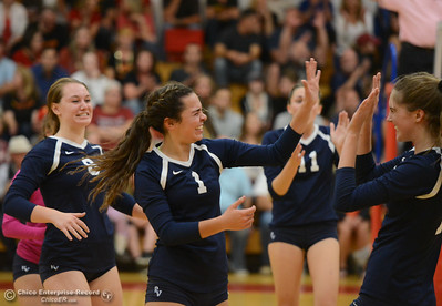 Pleasant Valley's Makenna Joyce celebrates with teammates after a strong point won against Chico High Thursday October 5, 2017 at Chico High School in Chico, California. (Emily Bertolino -- Enterprise-Record)