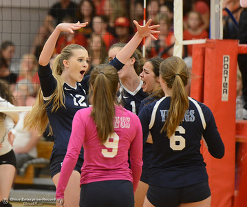 Pleasant Valley's Colette Florentine (12) and team celebrate after a point won against Chico High Thursday October 5, 2017 at Chico High School in Chico, California. (Emily Bertolino -- Enterprise-Record)