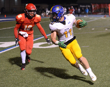 Sutter's Trever Facey catches before being tackled by Chico High's Kobe Hood Friday September 29, 2017 Asgard Yard in Chico, California. (Emily Bertolino -- Enterprise-Record)