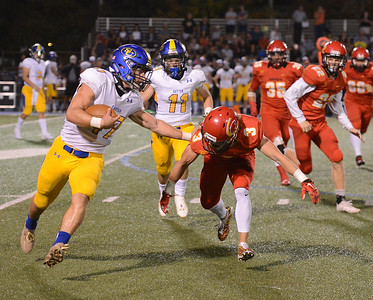 Sutter High's Bryce Kunkle evades Chico High's Ethan Bainbridge during a football game Friday September 29, 2017 Asgard Yard in Chico, California. (Emily Bertolino -- Enterprise-Record)