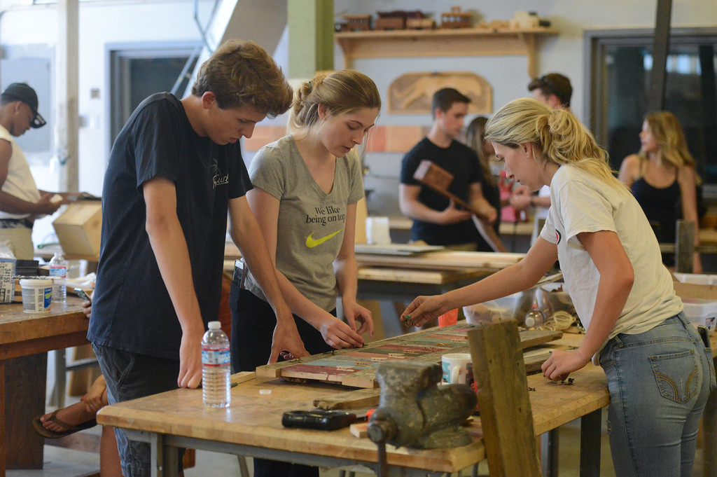 . Jenna Ploog, Dixie Thomas and Maxwell Rei work on a wooden project, May 18, 2018,  in Chico, California. (Carin Dorghalli -- Enterprise-Record)