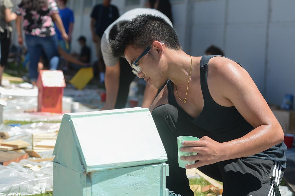 . Tini Thao paints a birdhouse, May 18, 2018,  in Chico, California. (Carin Dorghalli -- Enterprise-Record)