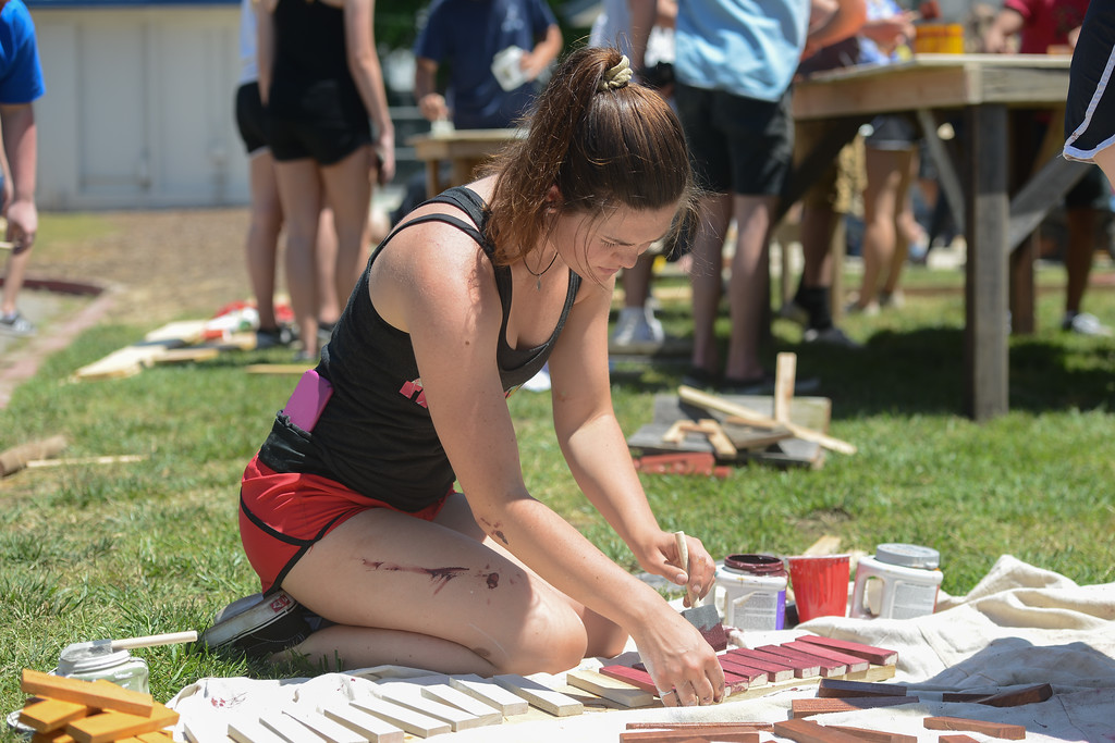 . Taylor Hensley paints a piece of wood, May 18, 2018,  in Chico, California. (Carin Dorghalli -- Enterprise-Record)