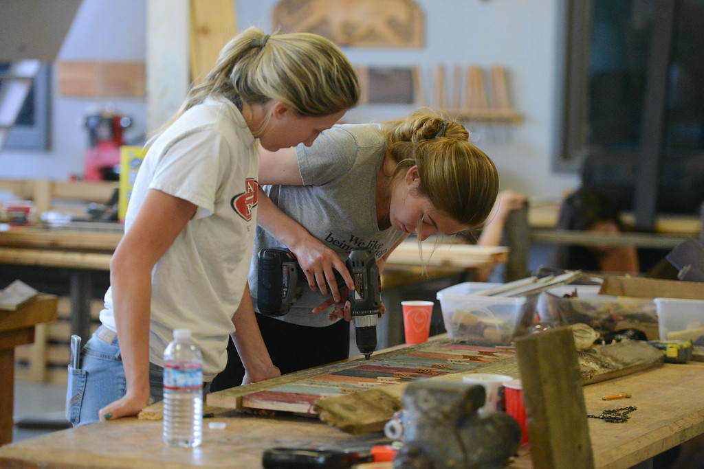 . Jenna Ploog and Dixie Thomas work on a wooden project, May 18, 2018,  in Chico, California. (Carin Dorghalli -- Enterprise-Record)