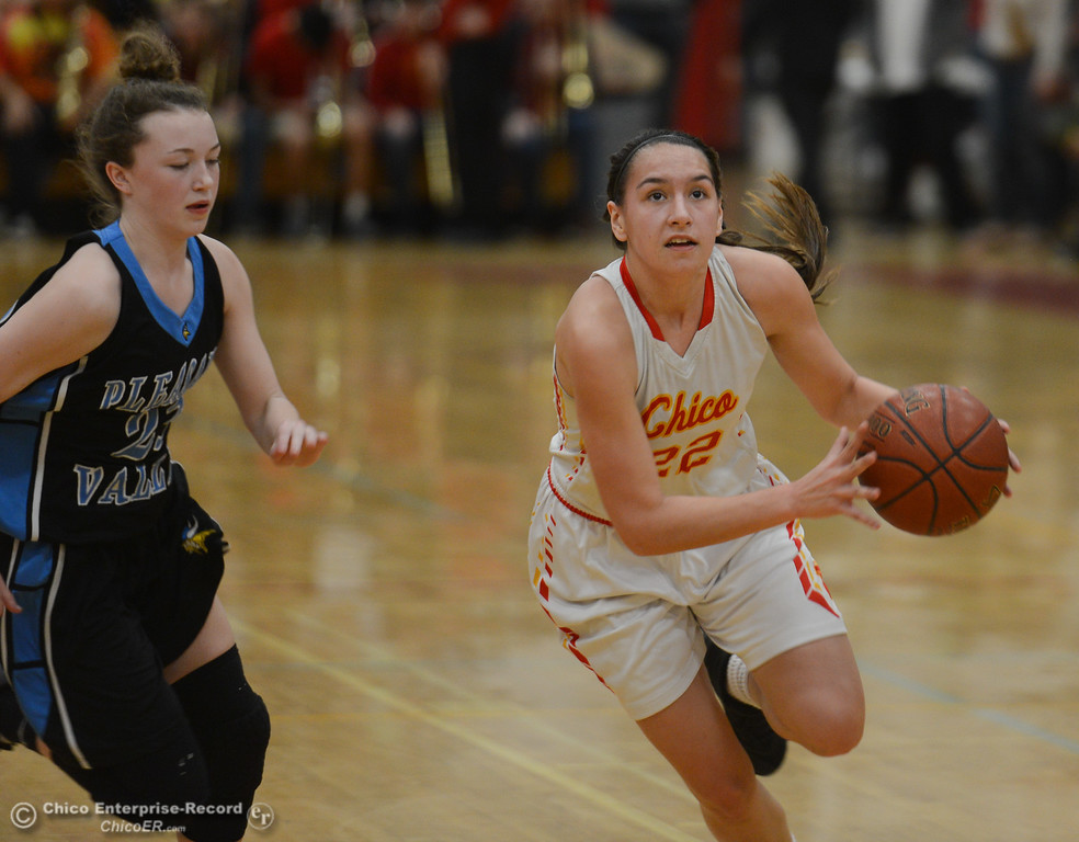 . Chico High\'s Elyana Croninger (22) dribbles past Pleasant Valley\'s Shaley Vieg (23), Thursday, February 8, 2018, in Chico, California. (Carin Dorghalli -- Enterprise-Record)