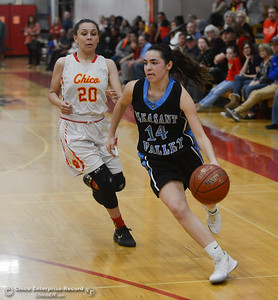 Pleasant Valley's Makenna Joyce (14) dribbles past Chico High's Elicia Stein (20), Thursday, February 8, 2018, in Chico, California. (Carin Dorghalli -- Enterprise-Record)