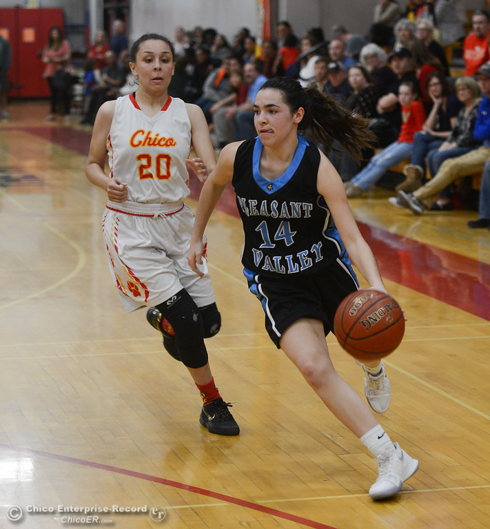 . Pleasant Valley\'s Makenna Joyce (14) dribbles past Chico High\'s Elicia Stein (20), Thursday, February 8, 2018, in Chico, California. (Carin Dorghalli -- Enterprise-Record)