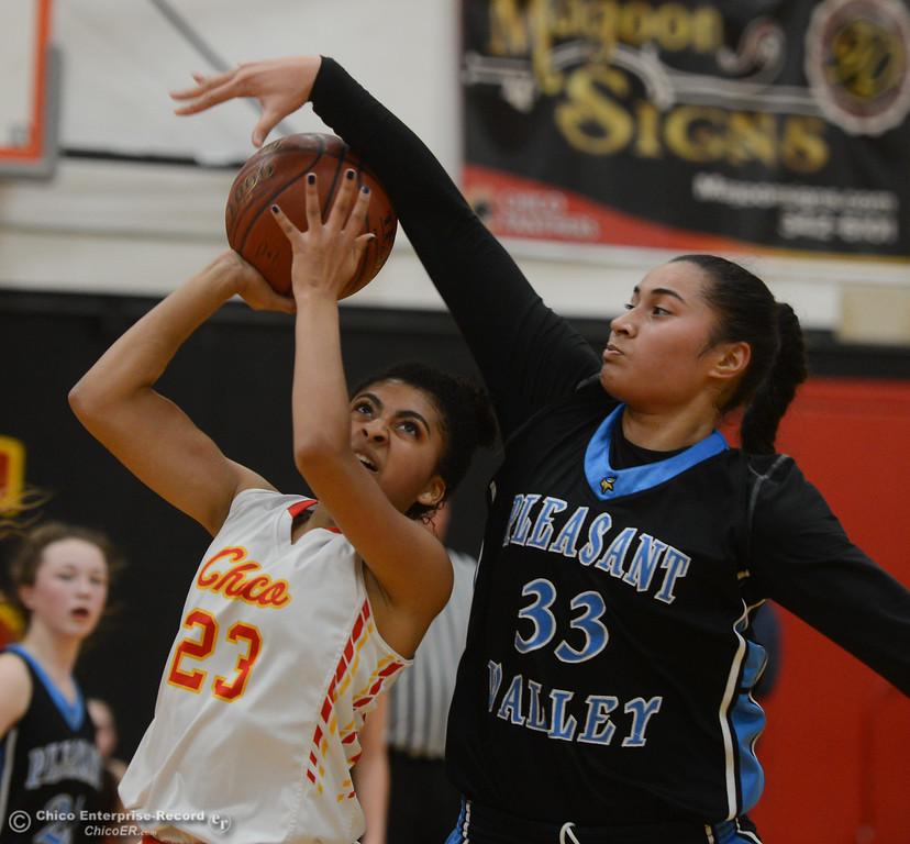 . Pleasant Valley\'s Sirena Tuitele (33) blocks Chico High\'s Adrianie Servin-Smith (23), Thursday, February 8, 2018, in Chico, California. (Carin Dorghalli -- Enterprise-Record)