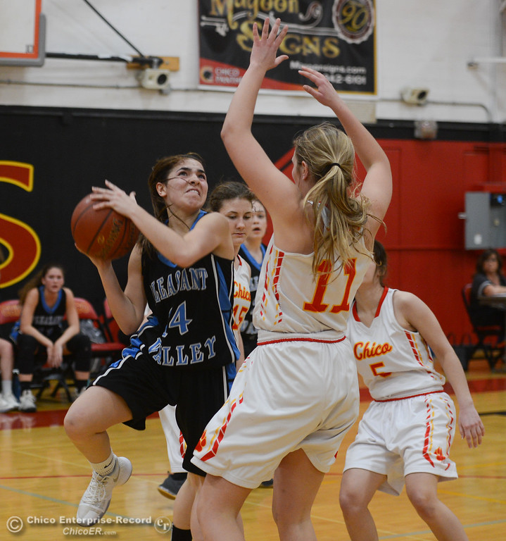 . Pleasant Valley\'s Makenna Joyce (14) goes up for a shot against Chico High\'s Adair Hotmer (11) and Mary Skillicorn (5), Thursday, February 8, 2018, in Chico, California. (Carin Dorghalli -- Enterprise-Record)