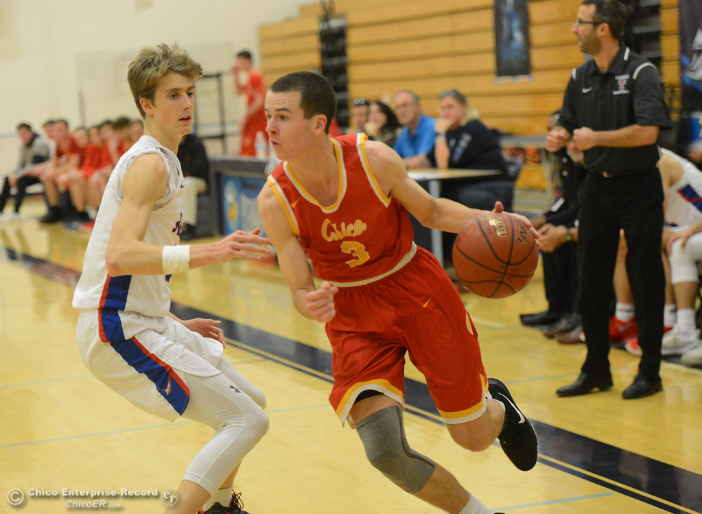 . Chico High\'s Jackson Bragg drives towards the baseline past Tamalpais\' Josh Love on the first night of the annual McDonald\'s Winter Classic Thursday December 7, 2017 at Pleasant Valley High School in Chico, California. (Emily Bertolino -- Enterprise-Record)