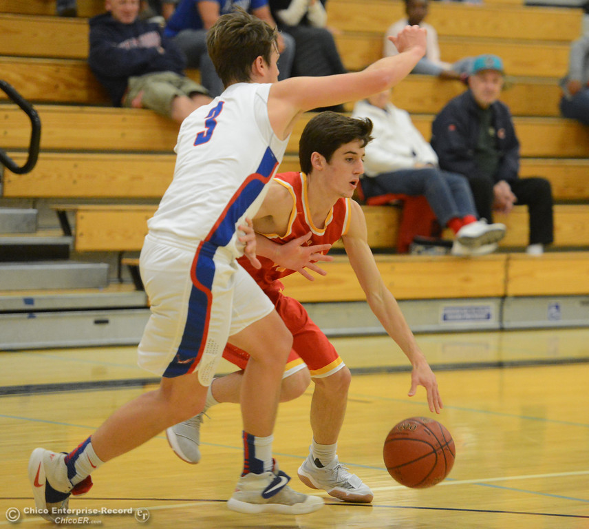 . Chico High\'s Tyler Willis dribbles around Tamalpais\' Ryan Hemmeter on the first night of the annual McDonald\'s Winter Classic Thursday December 7, 2017 at Pleasant Valley High School in Chico, California. (Emily Bertolino -- Enterprise-Record)