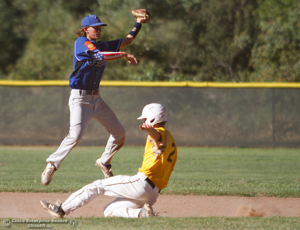 . Chico Nuts\'s Walt Askea jumps to catch the ball as  Ryan Branson slides under him to second Tuesday July 11, 2017 at Ron Doryland Field in Chico, California.  (Emily Bertolino -- Enterprise-Record)