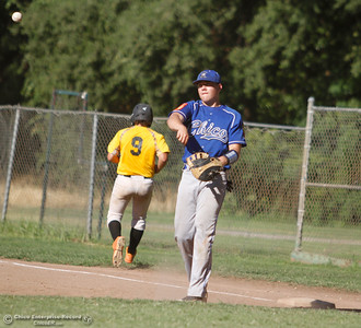 Chico Nuts's Mark Taylor throws the ball back in after tagging Feather River Gold's Anakin Borghi out at first Tuesday July 11, 2017 at Ron Doryland Field in Chico, California.  (Emily Bertolino -- Enterprise-Record)