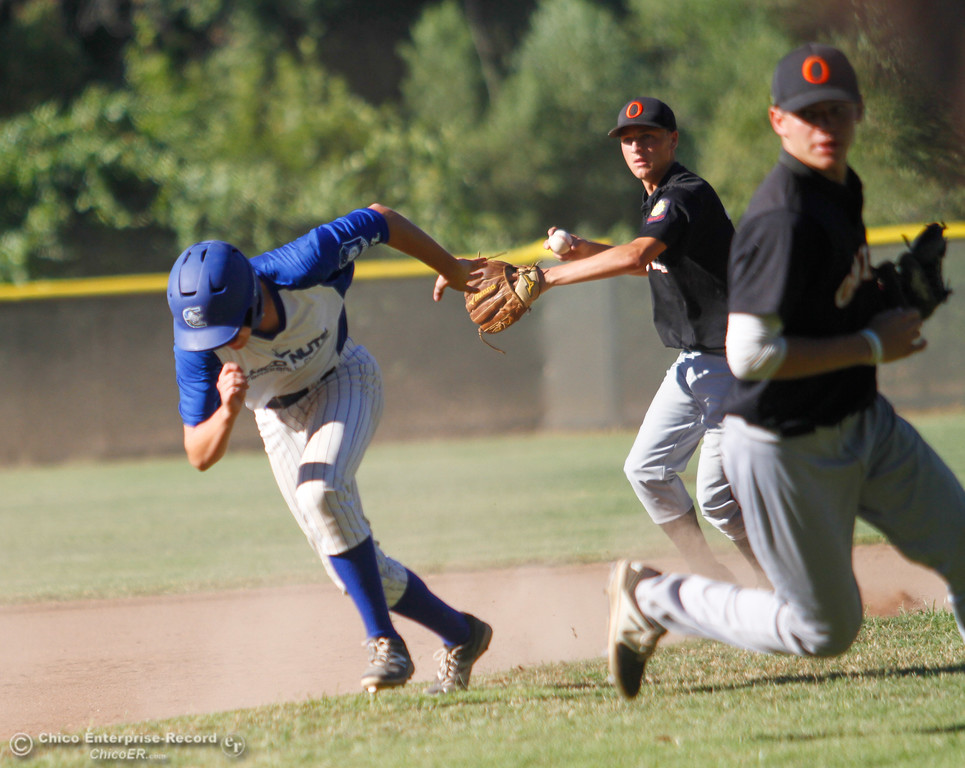 . Chico Nuts\'s Andrew Long races to third as Oroville Post 95\'s Parker Paul throws to Aaron Ruedi for the tag out Wednesday July 12, 2017 at Ron Doryland Field in Chico, California.  (Emily Bertolino -- Enterprise-Record)