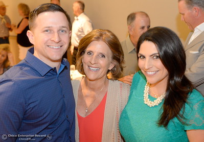 Hall of Fame Inductee Eileen Mason, center smiles with her children David Mason and Nikki Mason during the 46th annual Chico Sports Hall of Fame and Senior Athletes Banquet at the Chico Elks Lodge  in Chico, Calif. Tuesday May 8, 2018. (Bill Husa -- Enterprise-Record)