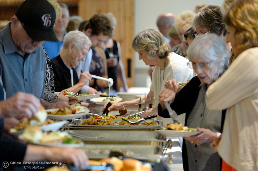 . People dig into the food during the 46th annual Chico Sports Hall of Fame and Senior Athletes Banquet at the Chico Elks Lodge  in Chico, Calif. Tuesday May 8, 2018. (Bill Husa -- Enterprise-Record)
