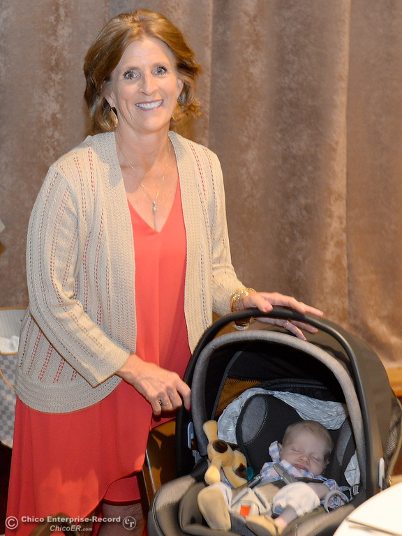 . Hall of Fame Inductee Eileen Mason smiles with her 4-week-old grandson Noah Mason-Simenton during the 46th annual Chico Sports Hall of Fame and Senior Athletes Banquet at the Chico Elks Lodge  in Chico, Calif. Tuesday May 8, 2018. (Bill Husa -- Enterprise-Record)
