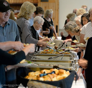 People dig into the food during the 46th annual Chico Sports Hall of Fame and Senior Athletes Banquet at the Chico Elks Lodge  in Chico, Calif. Tuesday May 8, 2018. (Bill Husa -- Enterprise-Record)