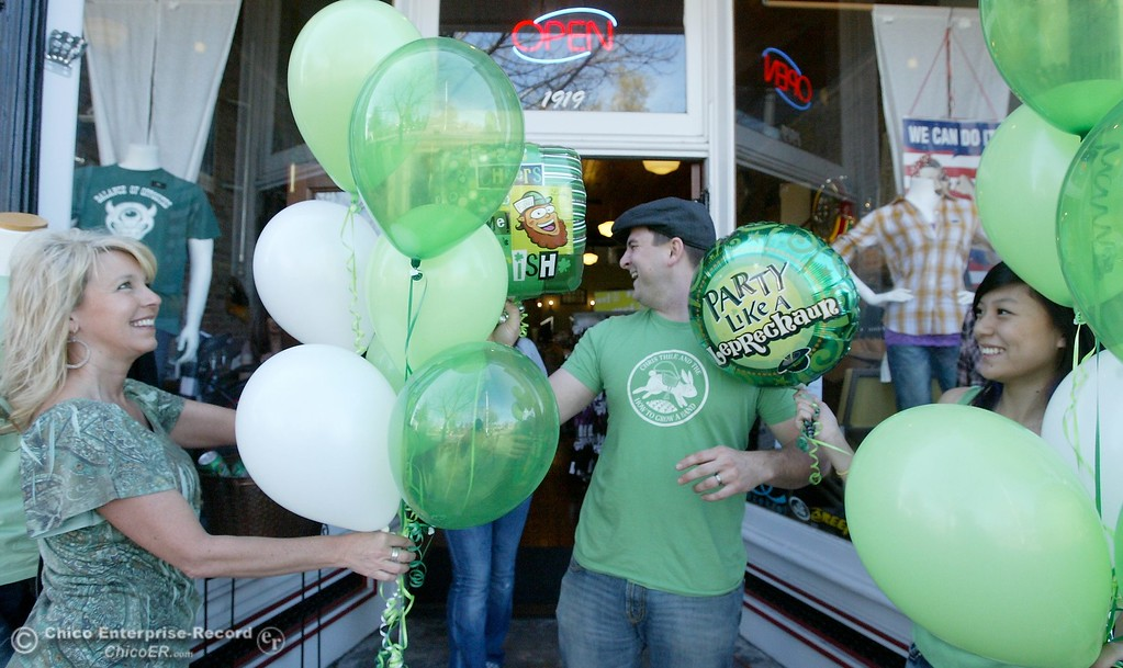 . At Left Kim Midkiff, Owner of Special EFX helps Nick Caspers and Nancy Saetern of Red Fly set up for the Red Fly/Special EFX St. Patricks Day event in front of the stores on Montgomery St. in downtown Oroville CA Wed. March 17, 2010. We do this every St. Patricks Day!