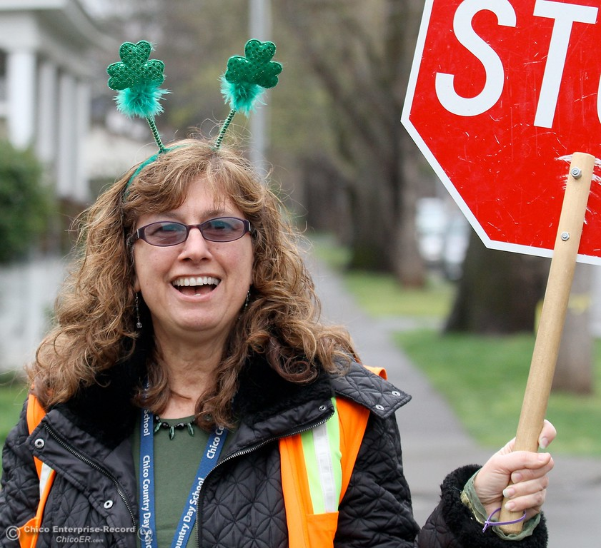 . Kindergarten Teacher/Crosswalk Guard Anne Marie Chik gets in the spirit of St. Patrick\'s Day with her clovers at Chico Country Day School in Chico CA Friday, March 16, 2012.  (Bill Husa/Chico Enterprise-Record)