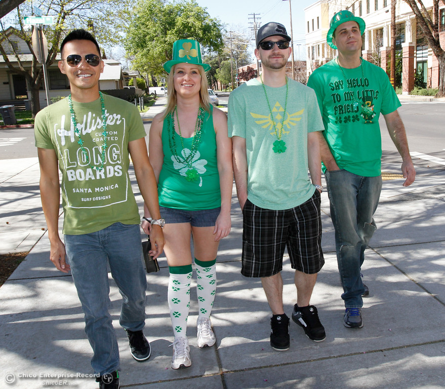 . Dressed and ready for St. Patrick\'s Day, friends Bian Bantes, Rachael Pendeton, Chase Newton and Michael Steiner talk do March 17, 2016 in downtown Chico, Calif. (Emily Bertolino -- Enterprise-Record)