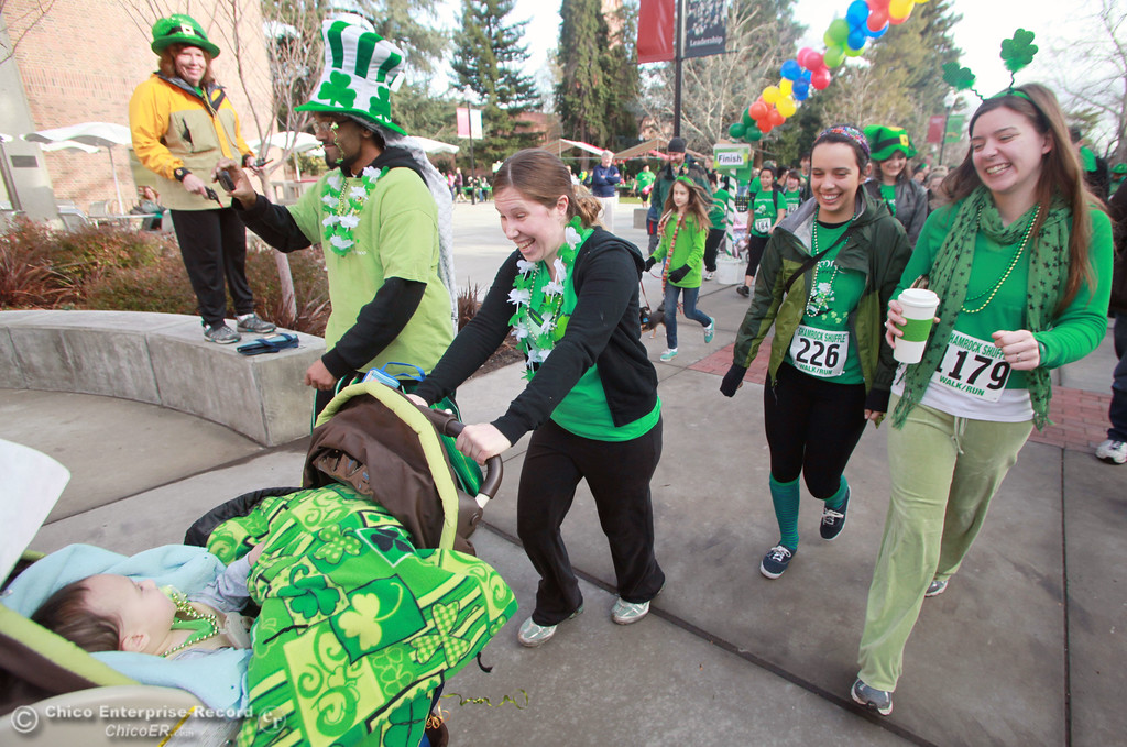 ". Canute ""Kindness\"" Davis, Kim Davis, Nicole Lee, Rebecca Gladden (left to right) with Xavier Davis, 9 months (below) begin a run/walk in the 11th Annual Shamrock Shuffle for St. Patrick\'s Day festivities on the Chico State campus Saturday, March 17, 2012 in Chico, Calif. 