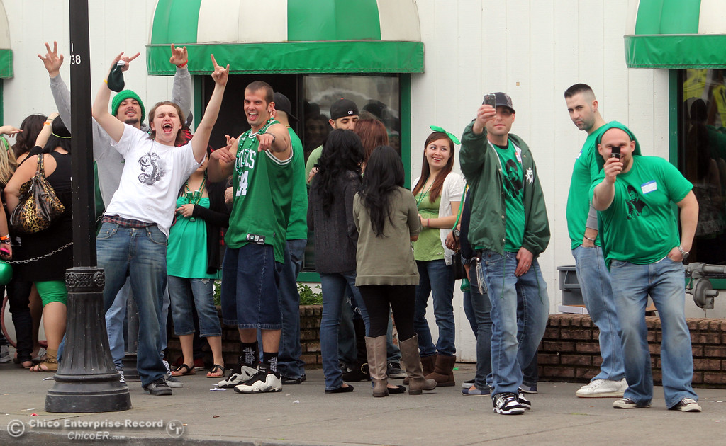 . People celebrate St. Patrick\'s Day festivities in line at Riley\'s in the south CSUC campus area and Downtown Chico Thursday , March 17, 2011 in Chico, Calif.