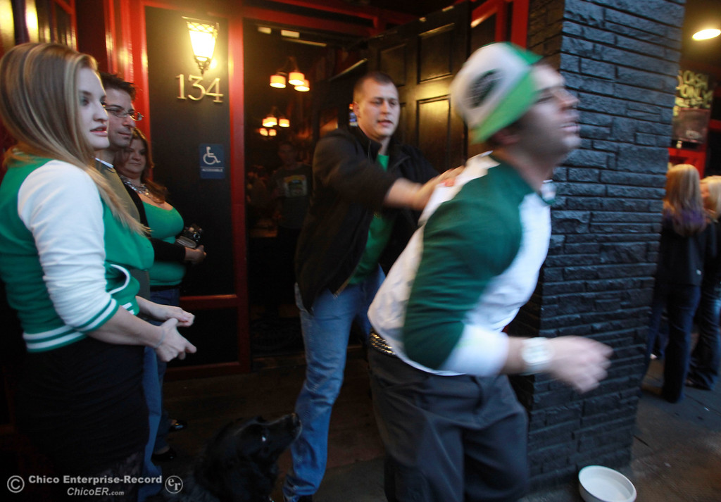 . A bouncer throws out a patron in the Banshee after causing a fight as they hit the town for something to celebrate during St. Patrick\'s Day Saturday, March 17, 2012 in downtown Chico, Calif. 