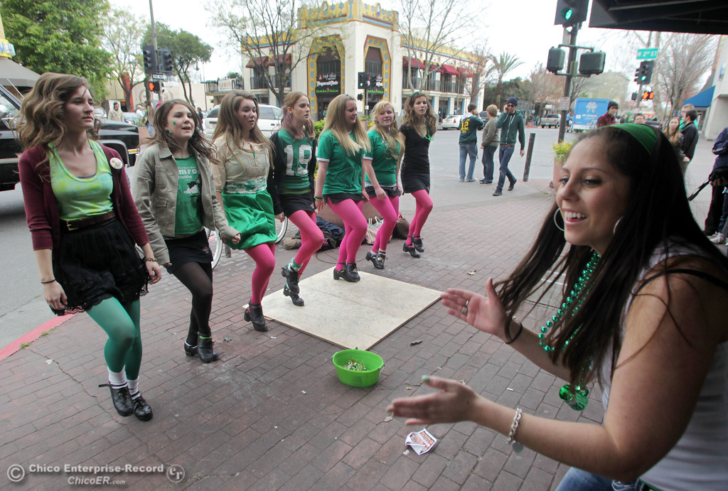 . The Oliver Academy of Irish Dance group, Lindsay Chamberlain, Maddie Mikles, Cara Cannon, Nile Reed, Abby Zuppan, Shannon Sullivan, and Rose Trulin (left to right) entertain Jaime Ramon, 24 (far right) and the public along Broadway at W 2nd St. as people celebrate St. Patrick\'s Day festivities in the south CSUC campus area and Downtown Chico Thursday , March 17, 2011 in Chico, Calif.
