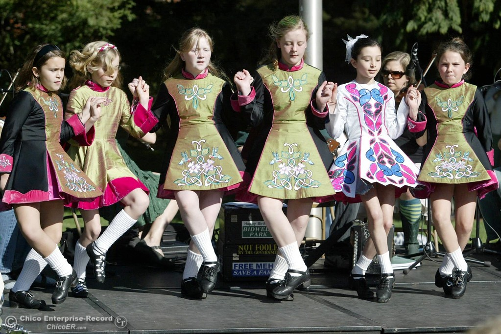 . Girls from the Oliver Academy of Irish Dance are accompanied with music by Pub Scouts as they dance for the public at the Shamrock Shuffle on the CSUC campus for St. Patrick\'s Day on Saturday, March 17, 2007 in Chico, CA. 