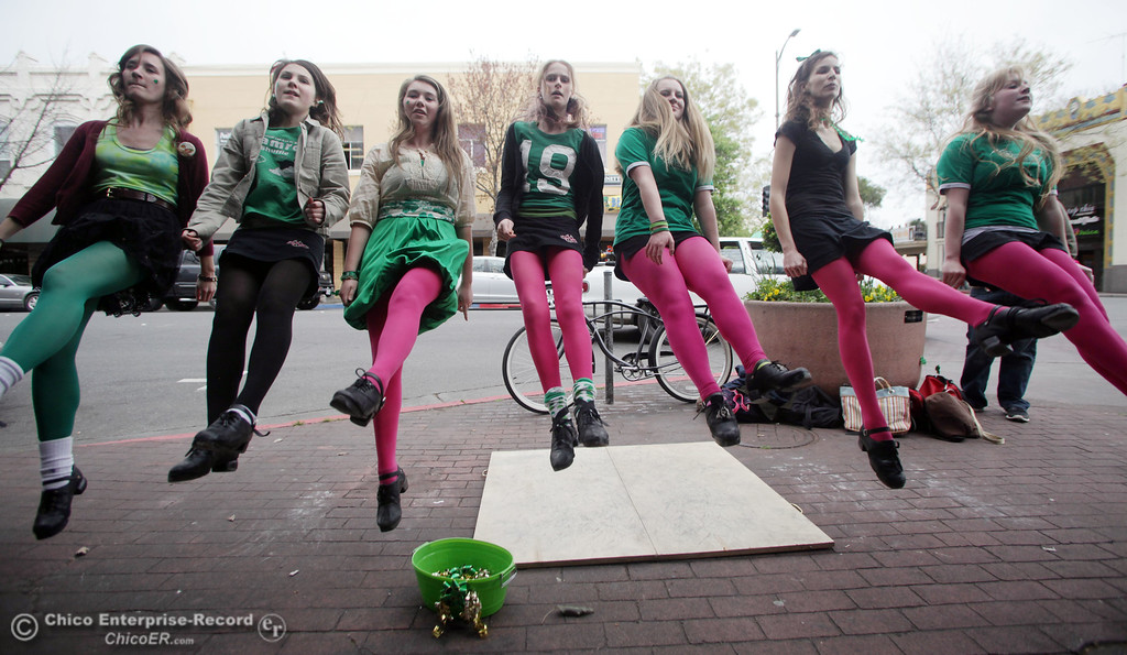 . The Oliver Academy of Irish Dance group, Lindsay Chamberlain, Maddie Mikles, Cara Cannon, Nile Reed, Abby Zuppan, Rose Trulin and Shannon Sullivan, (left to right) the public along Broadway at W 2nd St. as people celebrate St. Patrick\'s Day festivities in the south CSUC campus area and Downtown Chico Thursday , March 17, 2011 in Chico, Calif.