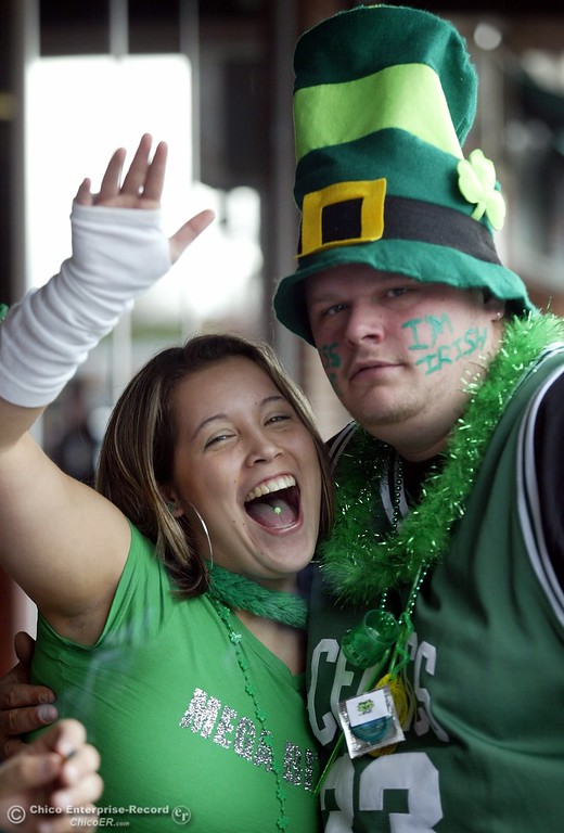 . Joe Drake of Paradise gets a hug from Nicole Tonelli of Chico as he gets his St. Patricks Day started on Main St. near the Town Lounge Friday morning.